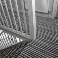 Striped carpet flooring to landing and stairs fitted by The Carpet Store Brandon